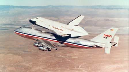 Space Shuttle Orbiter mounted on top of a Boeing 747 carrier aircraft, 1977. The Shuttle Orbiter is