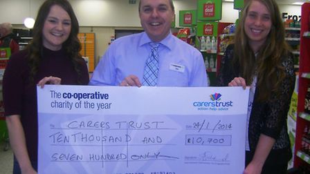 Co-op store manager Mike Mullett and fundraising co-ordinator Fiona Mason presenting a cheque for £