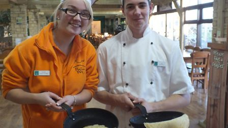 Georgia Cox and Mitch Knapp making pancakes at the park