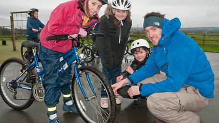 Rosalie, Lucy and Harvey learning about bicycle maintenance with Sole Cycling instructor Marc Molloy