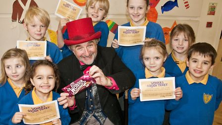 Willy Wonka and pupils with some golden tickets.