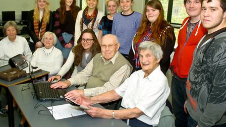 Clevedon School sixth form pupils teaching older people how to use Ipads.