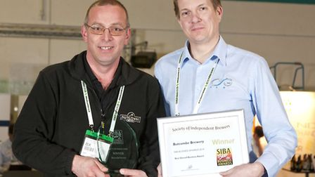 Martin Holland Butcombe Brewery Off-Trade Sales Director receiving top business award from SIBA