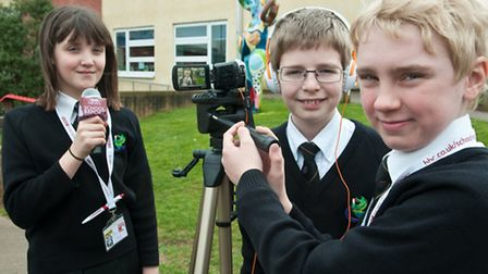 Molly Willcox, Joshua Gullock and James Dinum filming a report.