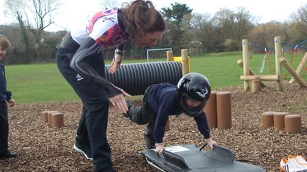 Winter Olympic competitor Katharine Eustace teaching children at Flax Bourton Primary School about t