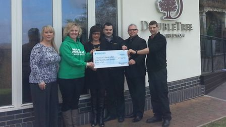The Broad Community Trust handing over the cheque.