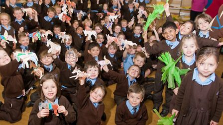 Children with palms and donkeys they have made to mark Palm Sunday.