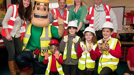 Willmott Dixon safety mascot Ivor with staff and pupils.