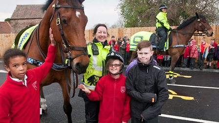 Pippa, Millie, Imogen and Will meeting PC Trudie Gunn and police horse Somerset.