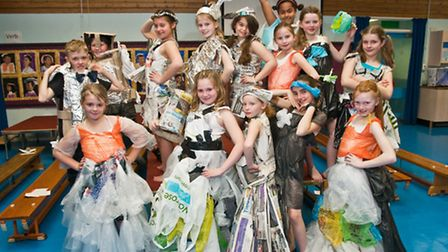 Pupils with clothes made from plastic bags, foil and newspapers.