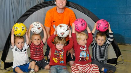 Football Fun 4 Little 1s coach Andy Withers with youngsters.