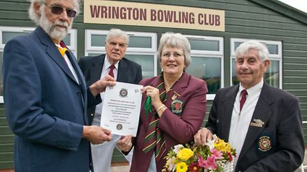 Pete Johnson(left) receiving Life Membership of Wrington Bowls Club in recognition of his work in de
