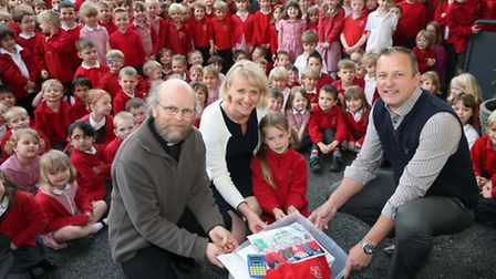 Pupils at St Peter's Primary School burying the time capsule.