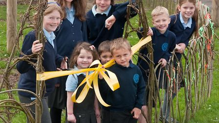 Pupils cutting the ribbon across the willow arch.
