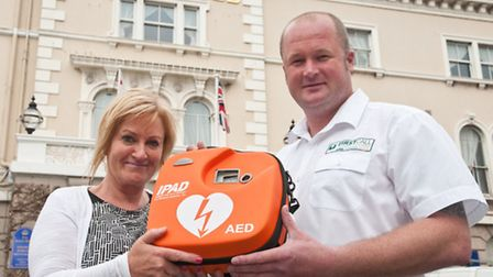 HR Director Julie Yianni with the defibrillator and Paul White, from First Call Training Solutions,