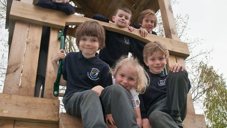 Pupils playing on the brand new climbing equipment provided by Siniat, in the KS1 playground.