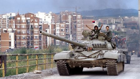 Serb forces withdraw from Pristina, June 1999. Photo: MERILLON/Gamma-Rapho via Getty Images.