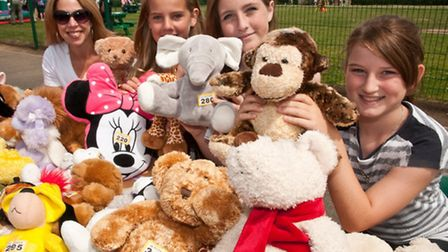 Jacqui Dumville from Friends of Trinity with helpers Amelia, Kacie and Charlotte on the Teddy Tombol