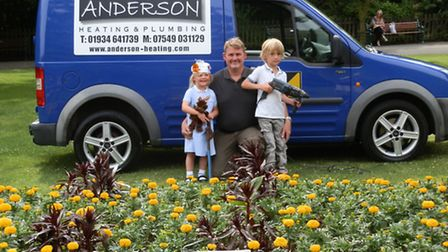 Kyle Anderson from Anderson Heating and Plumbing with children.