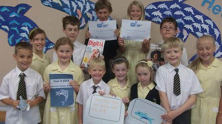 Pupils from St Joseph's Primary School celebrating their e-safety award.