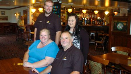 New landlords Paul and Mandy Boundary and their children Steven and Iona, Borough Arms, Locking Roa