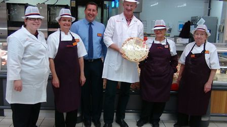 John Penrose with staff at Sainsbury's store in Worle.