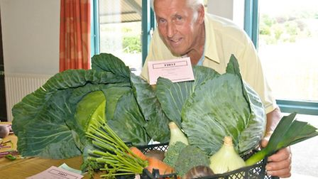 Gerald Dally with his prize winning basket of vegetables and his specimen cabbage which won 'Best in