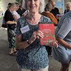 Maggi Stowers with the booklet created by the history society