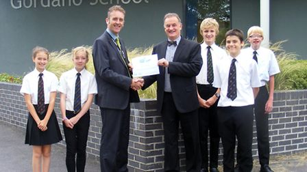 Gordano School's head of e-learning Graham Manson receives the award from South West Grid for Learni