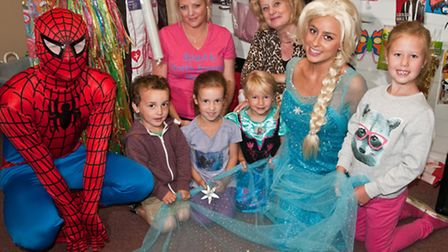 Shop owner Francine Hunt with Michelle Baden-Daintree, Spiderman, Princess Elsa and children.