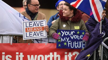 A pro-Brexit protester interacts with a supporter of a second EU referendum outside the Houses of Pa