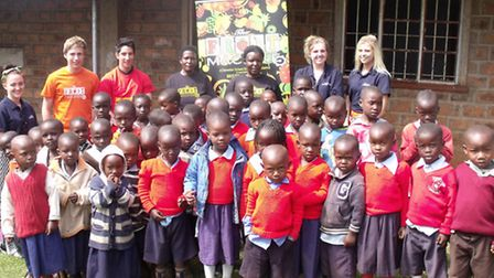 Children and teachers from Kenya supported by Clevedon and Backwell students' fruit machine project.