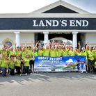 Cyclists celebrate completing their sponsored challenge to raise money for defibrillators in Portis