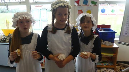 Pupils from Golden Valley Primary School baking mini Victorian sandwiches.