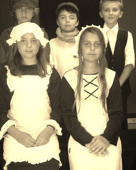 Pupils pose for a typical Victorian photo.