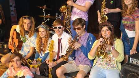 Bands and musicians with their instruments taking part in a music festival for the school RAG.