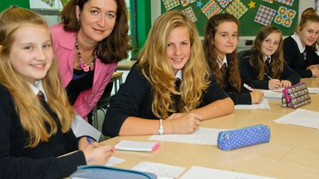 Poet Fiona Hamilton running a poetry workshop with year eight students.