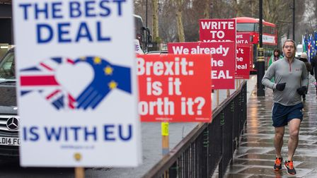 Anti-Brexit signs outside the Houses of Parliament. Photograph: Dominic Lipinski/PA.