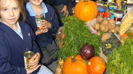 Pupils with harvest gifts at St Mary's Church.
