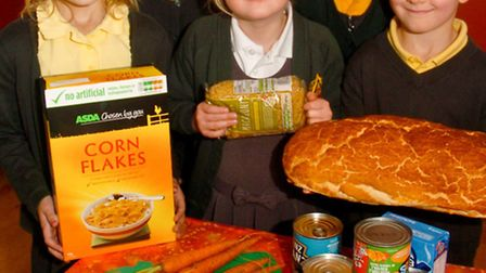 Trinity Primary School, Portishead pupils collected goods for harvest festival with Don Coghill from