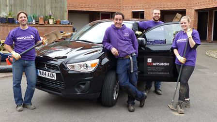 Volunteers of the WellChild Helping Hands project with the loaned cars.