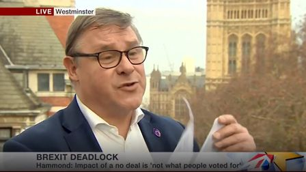 Mark Francois MP rips up a letter from Airbus on BBC News. Photograph: BBC.