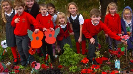 Birdwell Primary School, Long Ashton Pupils with poppies which they have planted in the school entra
