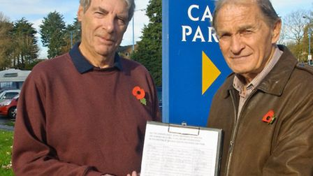 Barrie Garland and Gordon Hayton with their petition, at Crown Glass shopping centre car park.