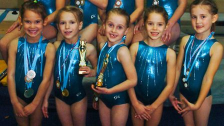 Artistic gymnasts with their medals from J21 Gymnastics Club.