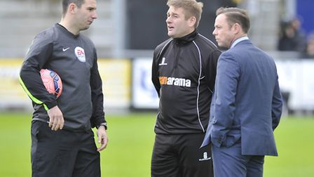 Doncaster Rovers manager Paul Dickov and Weston manager Micky Bell talk to referee Tim Robinson abou