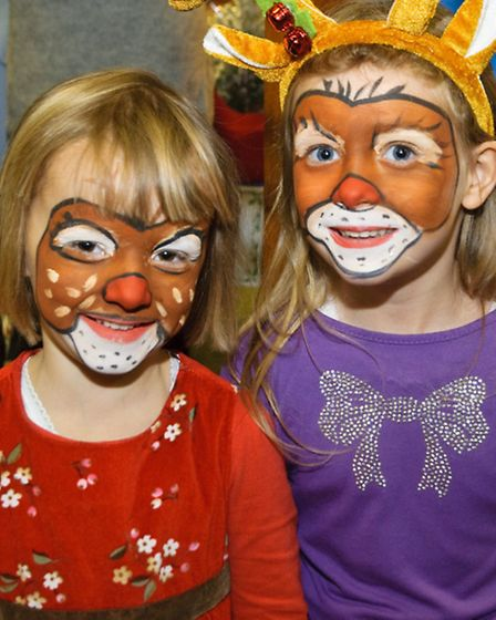 Phoebe and Willow with reindeer face paint.