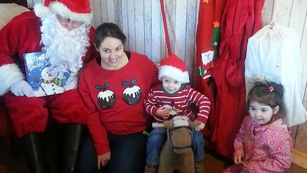Children meet Father Christmas at The Potting Shed's festive grotto.