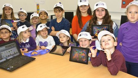 Children dressed in purple for the launch of the purple mash online learning website.