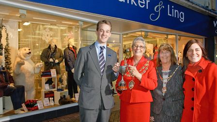 Sam Walker receiving the trophy from Mayor Ros Willis, with Mayoress Jos Holder and Weston Town Cent